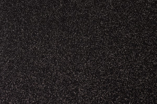 Glitter carpet swatch with silver sparkles on a black background
