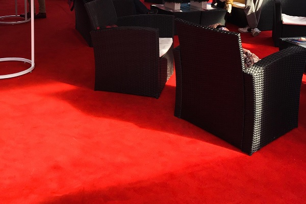 Cerise Black Tie carpet installed at an outdoor lounge