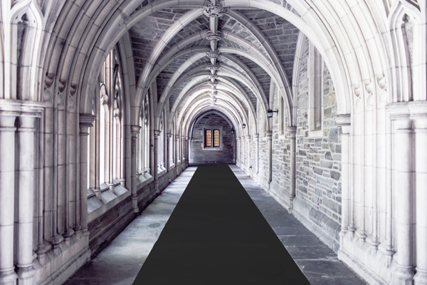 Charcoal event carpet installation in a gorgeous high-arched hall