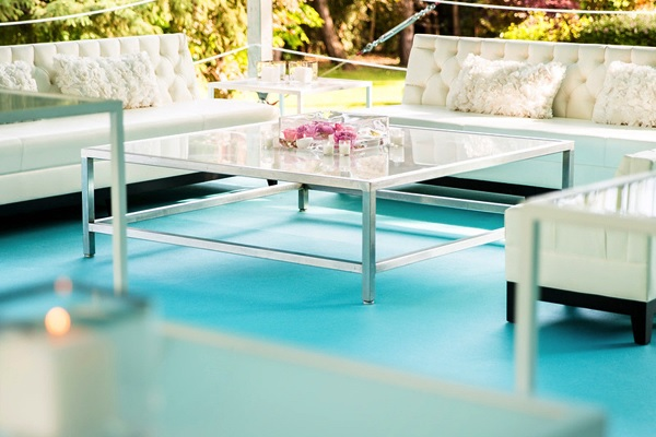 Serene turquoise lounge at an outdoor wedding