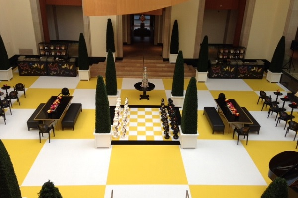 A chessboard made of yellow and chalk event carpet