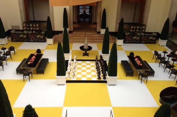 A chessboard made of yellow and chalk event carpet at the AGO