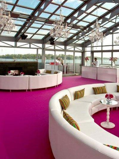 Hot pink event carpet in soaring atrium on the lake