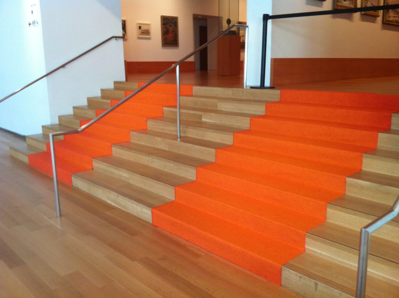 Orange event carpet runner installed on stairs