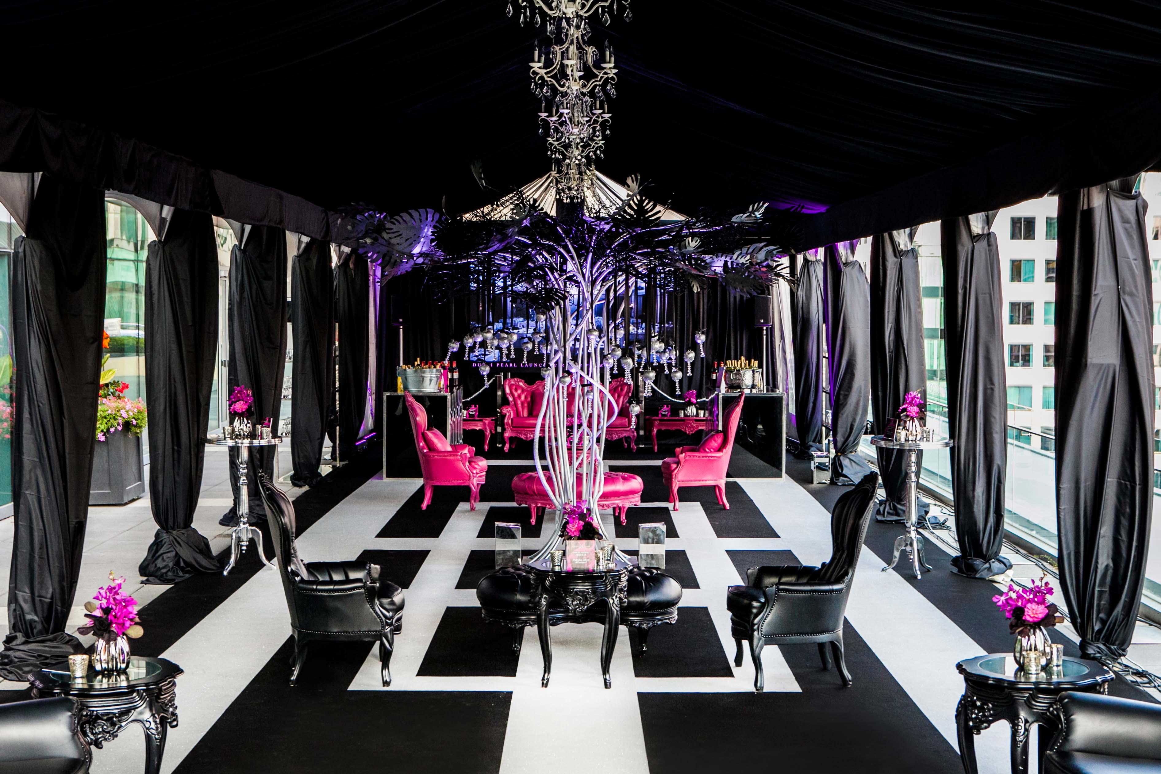 A custom tent floor design featuring Glitter Slate carpet inset into Black Event Carpet
