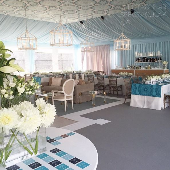 Grey event carpet with a custom chalk event carpet inset pattern at a tented wedding