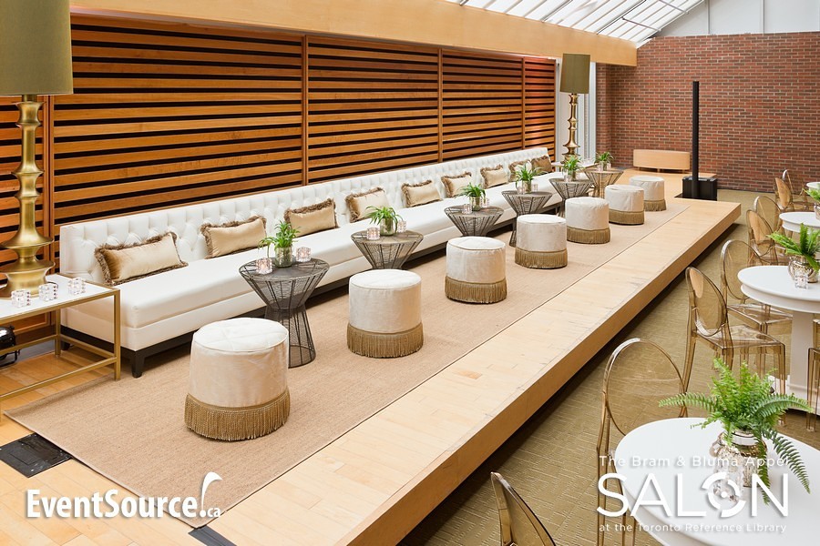 Naturals Carpet in Sisal Wheat in a lounge setting at a sleek industry night event