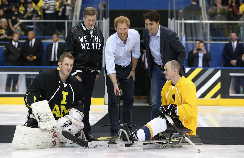 On Black Tie event carpet in Ebony black, Prince Harry drops the puck for a sledge-hockey match at the Mattamy Athletic Centre, while Canadian Prime Minister Justin Trudeau and Toronto Mayor John Tory look on